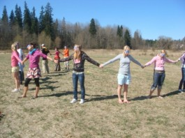 Group of people standing in an outwards facing circle